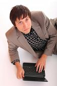 Attractive businessman with a netbook isolated on a white background