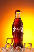 MOSCOW, RUSSIA - MAY 22, 2011: Classic  bottle Of Coca-Cola in ice studio shot.  Classic bottle of c