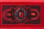 The red women clutch bag on white background