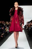 NEW YORK-FEB 10: A model walks the runway at the Dennis Basso fashion show during the 2014 Mercedes-Benz Fashion Week at the Theatre at Lincoln Center on February 10, 2014 in New York City.
