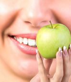 White Healthy Teeth Woman.Vitamin for Health Teeth in Fresh Green  Apple