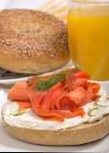 Delicious freshly baked Everything Bagel with cream cheese, lox (also known as salmon) and dill served with fresh orange juice