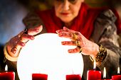 Female Fortuneteller or esoteric Oracle, sees in the future by looking into their crystal ball durin