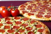stock photo of hot fresh pizza  - hot and fresh oven baked pizzas for family deal