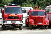 Petrovac, Montenegro – June 26, 2013: Photo Of Red Firefighters Trucks Based On Tam And Fap Yugoslav