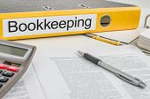 A yellow folder with the label Bookkeeping