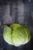 Savoy cabbage on dark slate.  Overhead view.