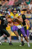VIENNA,  AUSTRIA - APRIL 21 QB Christoph Gross (#8 Vikings) runs with the ball during the AFL footba