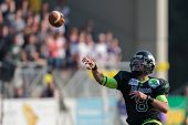 VIENNA,  AUSTRIA - APRIL 21 QB Jonathan Dally (#8 Dragons) throws the ball during the AFL football g