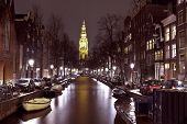City scenic from Amsterdam in the Netherlands with the Zuiderkerk at night