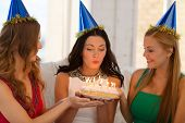 celebration, food, friends, bachelorette party, birthday concept - three smiling women wearing blue