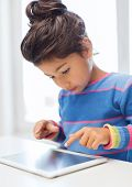 education, technology and internet concept - little girl with tablet pc