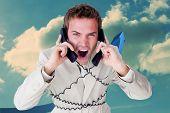 Confident businessman having a phone call against blue arrow pointing up against sky