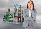 Thinking businesswoman against cloudy dull sky