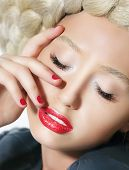 Glamorous Woman's Face Close-up Portrait. Red Lipstick And Fingernails