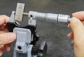 foto of micrometer  - Calibration Micrometer In Laboratory Center At Factory  - JPG
