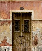 Antique Door In A House With Worn Stone Wall Texture.