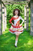 Young Woman In Irish Dance Dress Dancing Outdoor