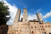 stock photo of piazza  - Towers and houses in Piazza delle Erbe and Piazza del Duomo San Gimignano medieval town  - JPG