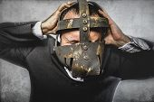 crazy, dangerous business man with iron mask and expressions
