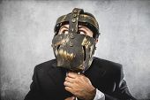 screaming, dangerous business man with iron mask and expressions