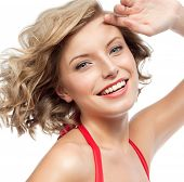 closeup portrait of attractive  caucasian smiling woman blond isolated on white studio shot lips too