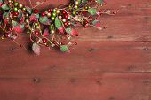 Christmas Wreath On Red Grunge Wood Background
