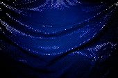 Dramatically Draped Blue Sequined Fabric Background