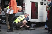 Mechanics check engine of wrecked bus