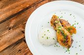 image of chinese parsley  - Baked chicken drumsticks with rise on wood table - JPG