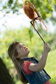 Little girl playing with pinwheel