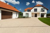 Modern House And Outbuilding With Garage
