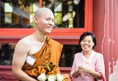 ordained Buddhist monk with mother