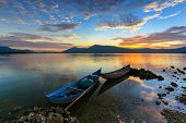 small boats in the lagoon in the sunrise. This scene is at Phan Rang city, Ninh Thuan Province, Viet