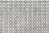 stock photo of grout  - White brick wall with black grout - JPG