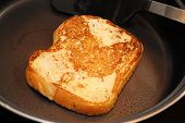 French Toast Cooked In A Black Fry Pan