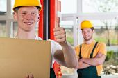 Blue-collar Worker Showing Thumbs Up Sign