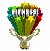 Fitness word in a gold trophy surrounded by stars celebrating your great score or results in a compe
