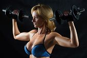 foto of breast-pump  - Low key silhouette of a fitness woman with dumbbells - JPG