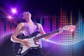 Pretty girl playing guitar against digitally generated disco light design