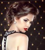 Elegant Brunette Woman Lady With Makeup And Hairstyle. Fashion Girl Model Over Bokeh Lights Backgrou
