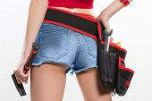 picture of ass  - girl holding a hammer next to the booty - JPG