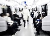 Abstract image of Japanese commuters in Tokyo. Blurred motion with lense zooming for impact.