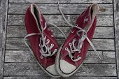 Old red canvas shoes