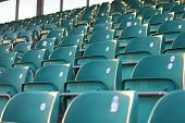foto of grandstand  - empty green grandstand seating in a regular symmetrical pattern