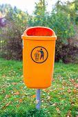 Orange plastic dust bin