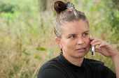 Middle-aged Woman Talking On Cell Phone
