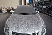 Car covered in volcanic ash