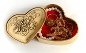 stock photo of casket  - Photo shows Heart Shaped bronze casket with jewelry - JPG