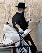 JERUSALEM, ISRAEL - OCTOBER 31, 2014: Two orthodox Jewish men praying at the Western Wall.